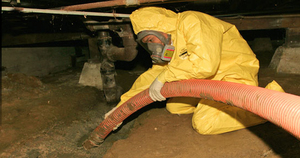 Fire Damage Restoration Reno Technician In Crawlspace